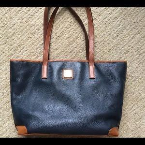 Classic Dooney Bourke in navy leather, brown trim.